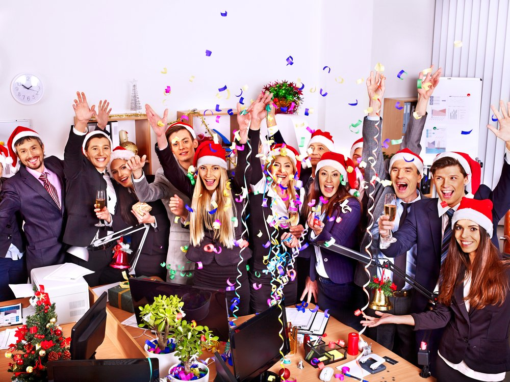 Happy group people in santa hat at office christmas party.